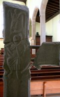 Rear of the early stone crucifix, now protected inside the church.