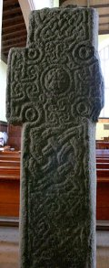Rear of the early Christian cross, now protected inside the church.