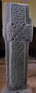 Front of the early Christian cross, now protected inside the church.