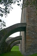 The buttresses of the Barbican on the north end of the east wall.