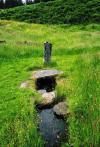 The holy well and cross slab.