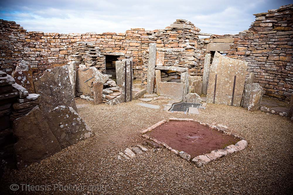 Inside the main broch tower with a large hearth in the middle of the floor.