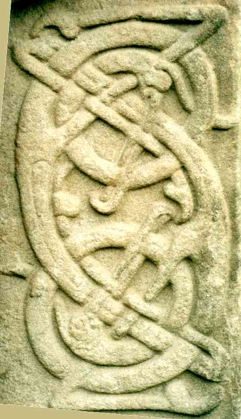 Detail of the interlaced creatures at the centre-right of the cross side.