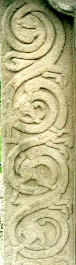 Detail of the interlaced creatures at the left of the cross side.