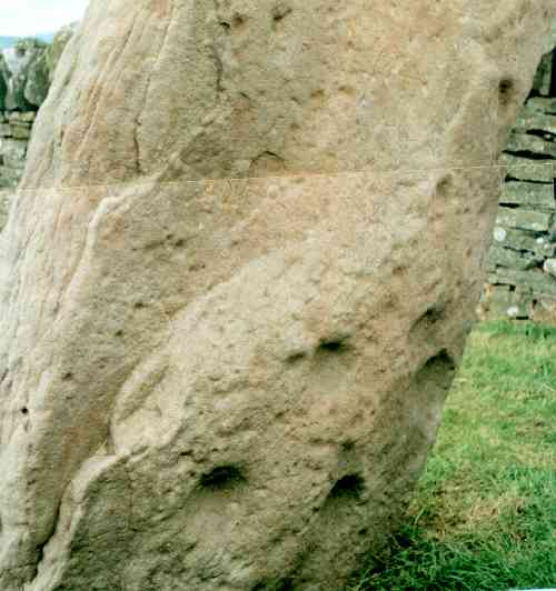 Cup marks on the back of the Serpent Stone.
