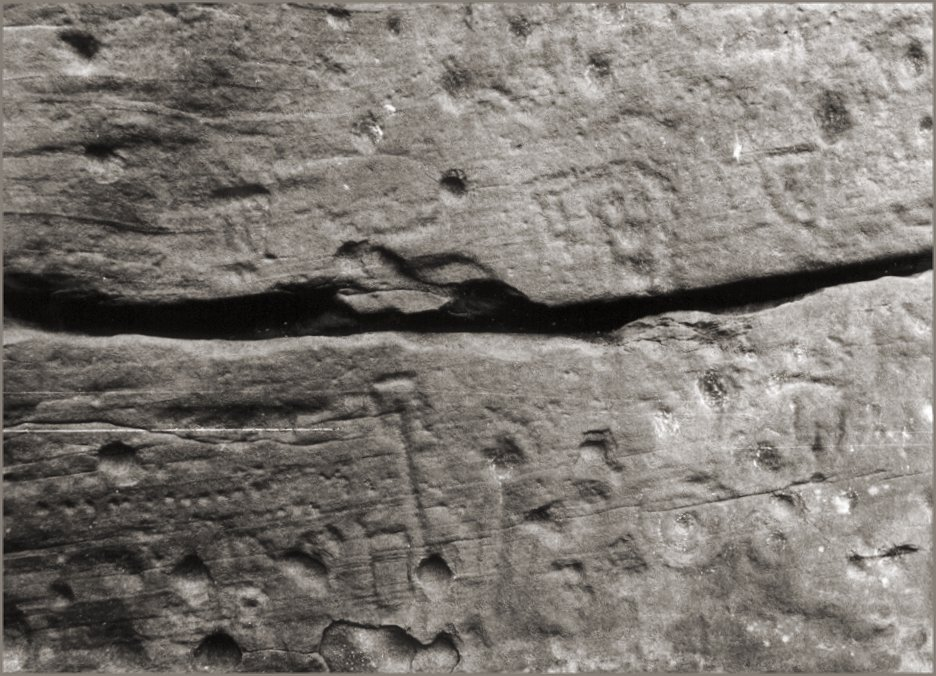 Rectilinear marks on the south wall.