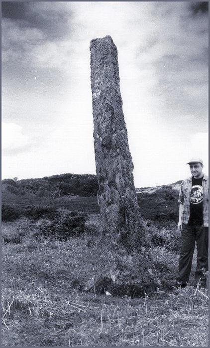 "Looking northwest with a 5'9"" yardstick.  The remains of Dun Calltuinn stand on the hill just over the yardstick's right shoulder."