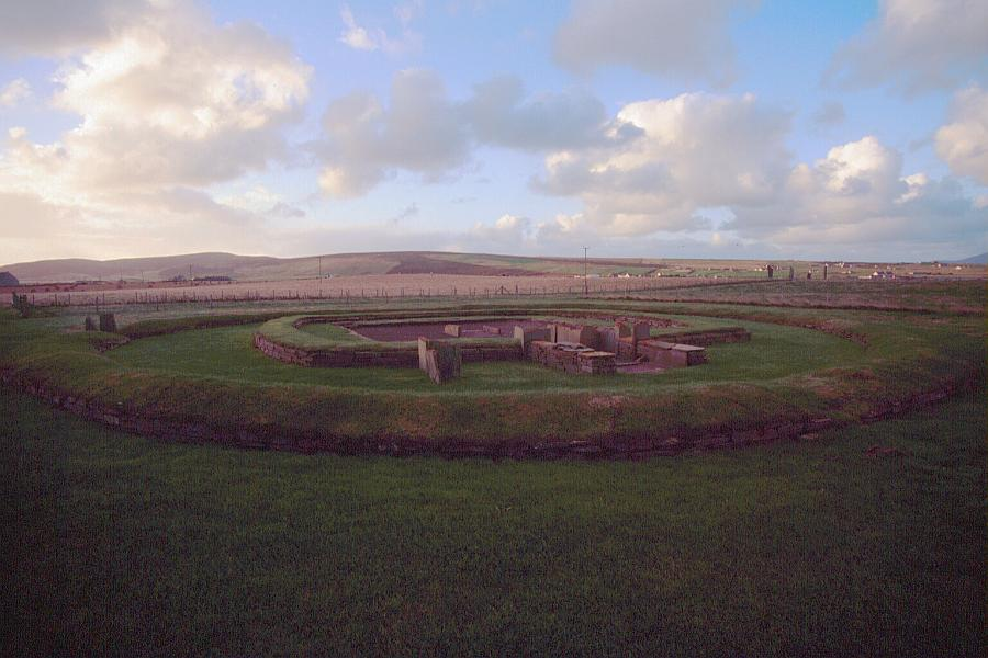 Structure 8.  The stones of Stenness can be seen in the distanceto the right of the building.