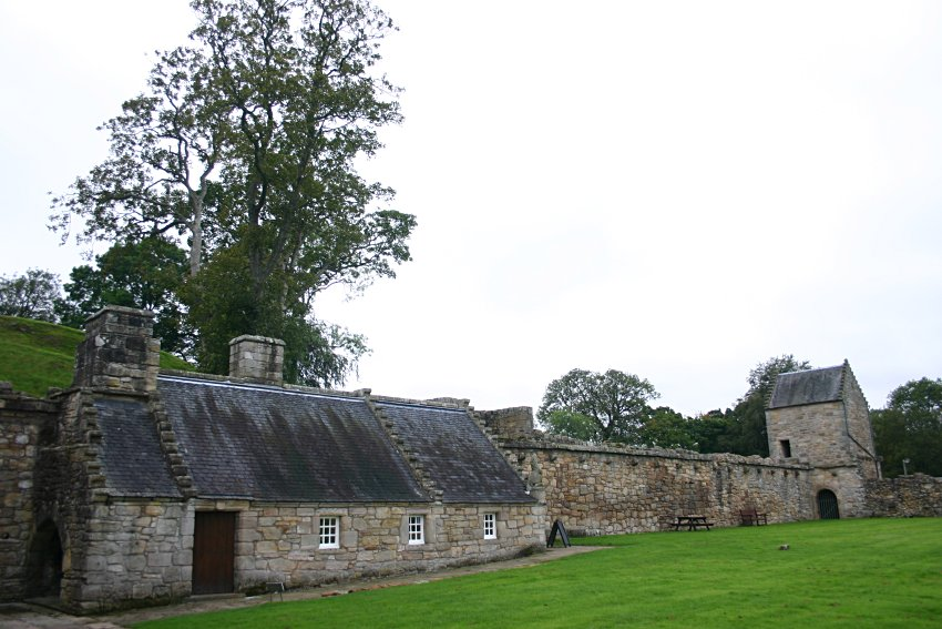 The curtain wall and outbuildings.