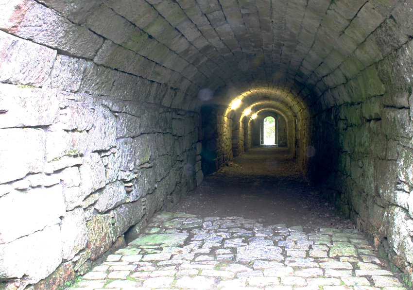 Vaulted corridor under the keep tower leading to the cellar vaults.