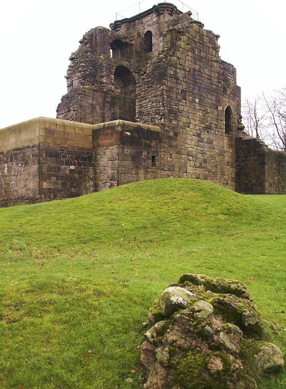 Looking from the southwest.  Bumps in the ground and bits of fallen wall are all that remain of the southwest tower.