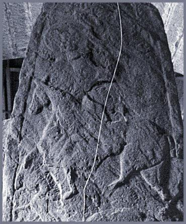 At the top of the stone is a double-disc-and-Z-rod; the left-hand disc can be seen.  Below is a horseman.