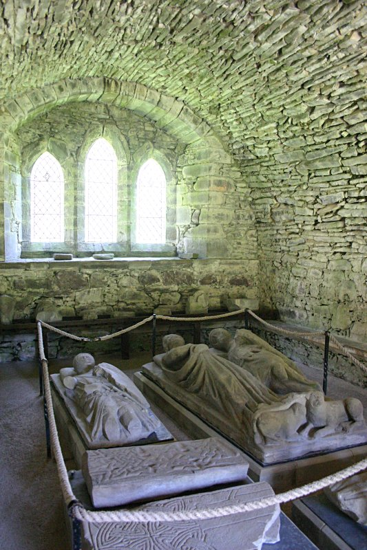 The inside of the chapter house - later to be a mausoleum. Lying on the left is the effigy of a Stewart knight.  On the right is the double effigy of Earl Walter Stewart (who died around 1295) and his countess.