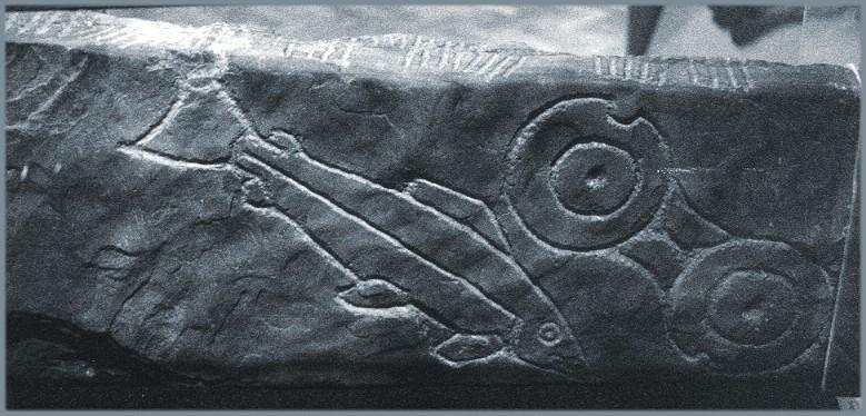 Inchyra: The double disc and salmon.  An ogam inscription is visible on the top edge.