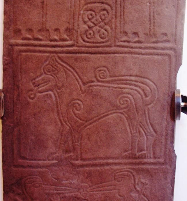 The central panel with a creature, perhaps a lion.