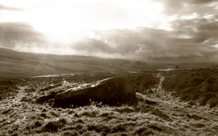 The northernmost stone of the row, looking southwest as the mist lifts from the moor.  The second stone in the row, the Wallace Stone, can be seen to the right in the distance.