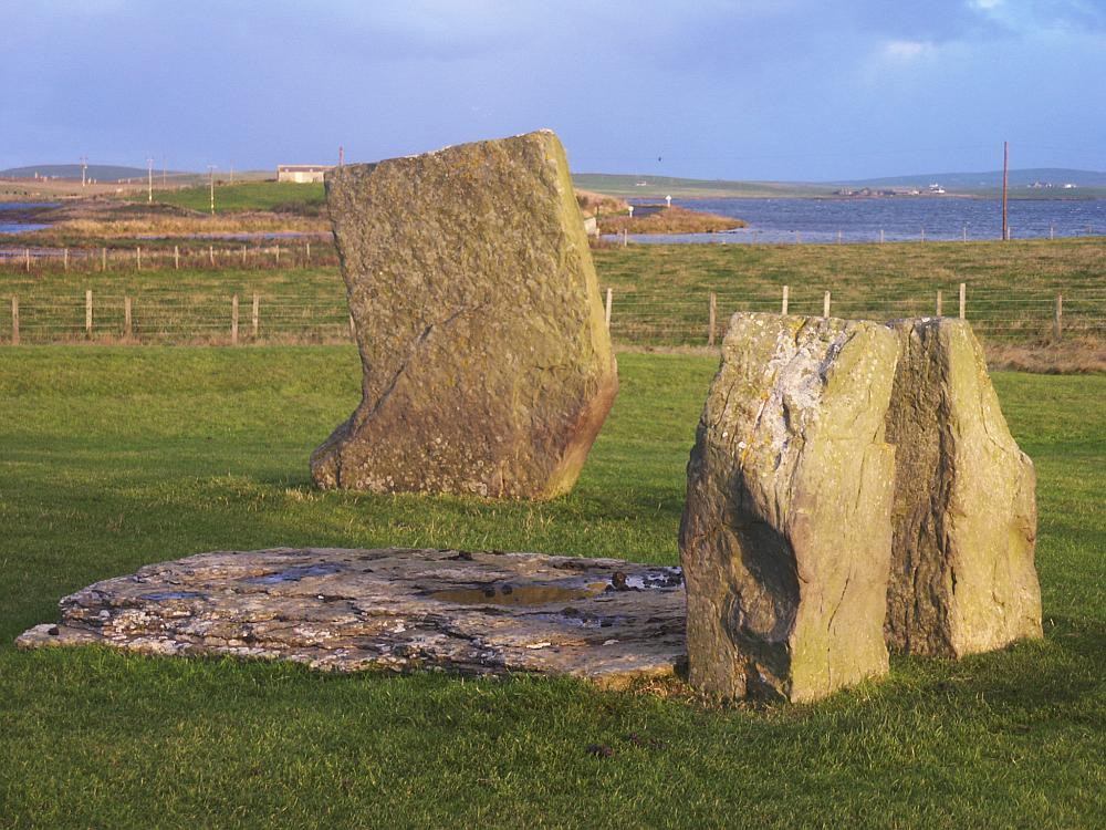 The inner setting of stones with the northern stone behind.  The Ring of Brodgar can just be seen in the distance at the left of the picture.