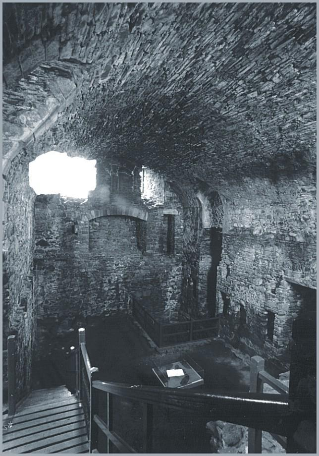 Looking south from the mezzanine to where the kitchen and reception would have been and belon into the cellar.  The large well is fenced off in the far corner.  Below and to the right of the picture is the prison - that must have been unpleasant for the kitchen staff!
