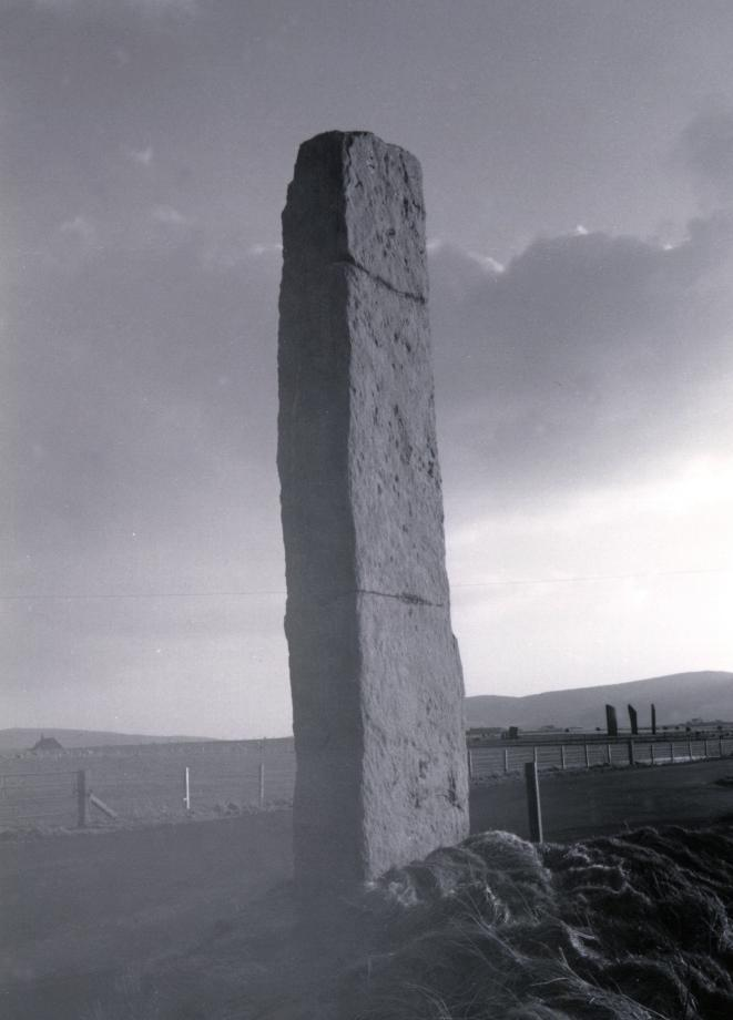 Looking southwest.  The Stones of Stenness can be seen in the distance to the right of the Watch Stone