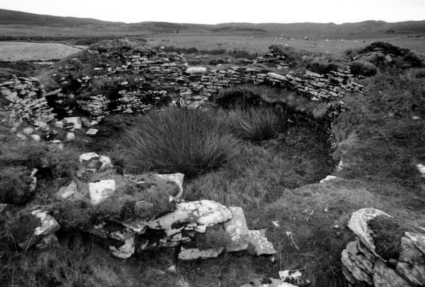 Looking southeast.  One entrance to the broch is in the wall opposite the camera.  The other entrance is in the far wall towards the left of the picture.